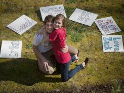 Zach Sierputowski asked his girlfriend Erika Houmann out to their prom at Greenville (S.C.) Tech Charter High School by posting these signs on the roadside near her home. She said yes.