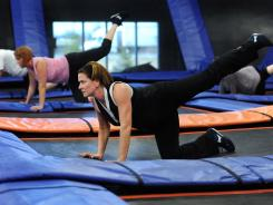 "Women work out on trampolines during a ""skyrobics"" class at Sky Zone in Fishers, Ind."