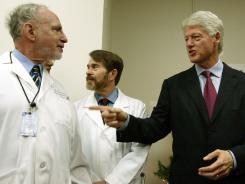 Former President Bill Clinton, right, speaks to Dr. William Frishman, left, chief of medicine at Westchester Medical Center. Clinton formally thanked the doctors at the Center for diagnosing the heart condition that led to his quadruple bypass surgery in August.