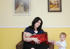 Keely Shaw, 30, feeds her 5 month old son Halston while her 2 year old Wiley plays. Both Keely's sons were born premature in the 35th week and drank breast milk from the milk bank while Keely waited for her body to produce milk. She now donates breast milk to The Denver Milk Bank, one of the only milk banks in the country.