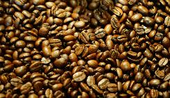 Roasted coffee beans are on display for sale at The Conservatory Coffee, Tea, and Cocoa, a family owned roasting coffeehouse in Culver City, Calif.