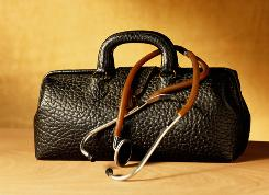 A doctor's bag and stethoscope. There are about 4,000 physicians who make house calls in the USA, a number expected to grow if part of the health care reform bill is successful.