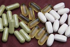 Echinacea, left, fish oil, center, and glucosamine pills are shown. Americans spend more than a 10th of their out-of-pocket health care dollars on alternative medicine, according to the first national estimate of such spending in more than a decade.