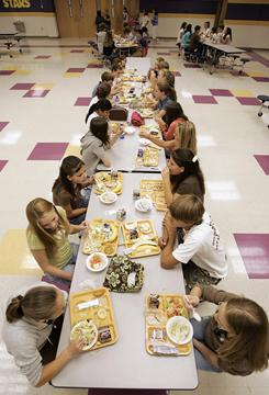 The proposed rule applies to school breakfast and lunch but not to what's sold in vending machines and school stores.