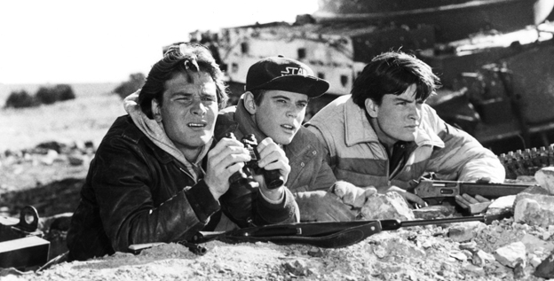 Patrick Swayze, left, C. Thomas Howell and Charlie Sheen starred in the original 'Red Dawn,' released in 1984, as a group of teenagers who defend their town from invading Soviet soliders.