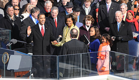 moment: President Obama is sworn in by Chief Justice John Roberts with the new first family and Vice President Biden, right, nearby. Sen. Dianne Feinstein, D-Calif., who headed the joint congressional inaugural committee, is to the right of Michelle Obama.