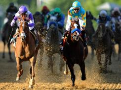 I'll Have Another ridden by Mario Gutierrez, left, beats Bodemeister, ridden by Mike E. Smith at the finish line to win the 137th running of the Preakness Stakes at Pimlico Race Course in Baltimore on Saturday.